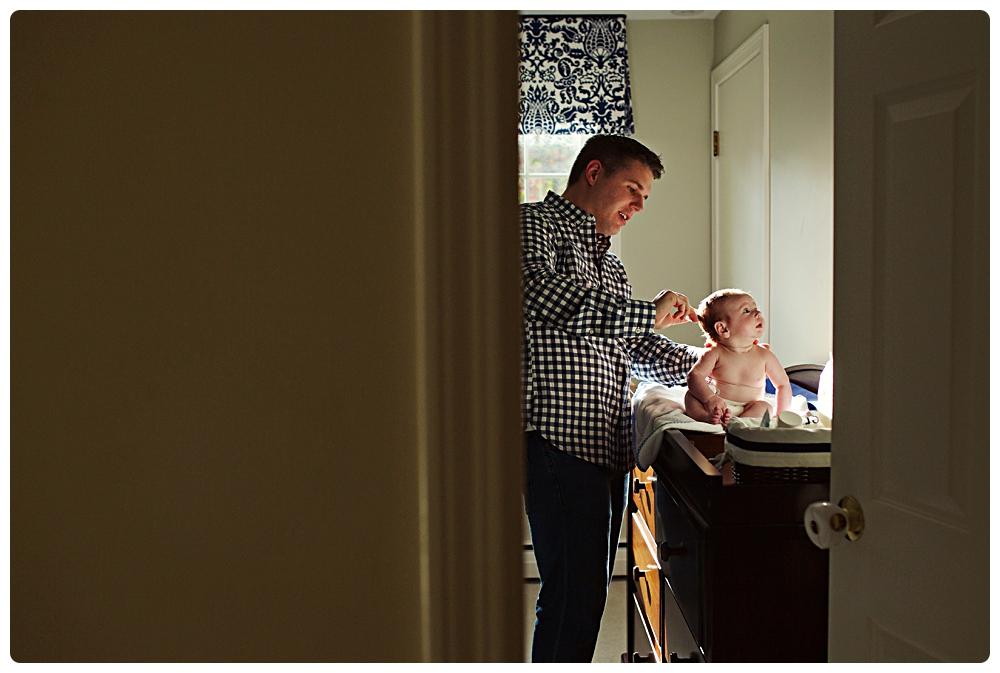 stunning father newborn son portrait