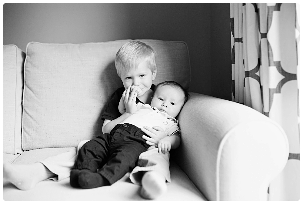 touching black and white sibling photo boston