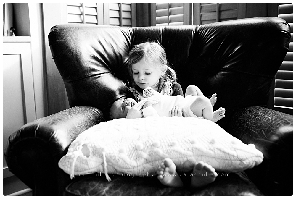 black and white newborn photography with sibling boston ma cara soulia