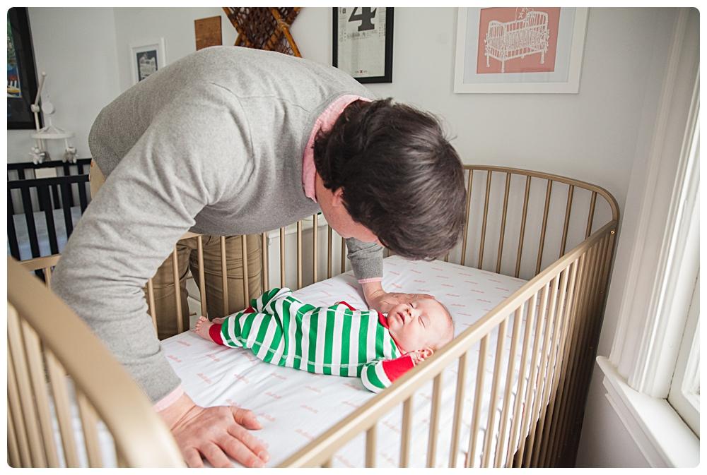 touching newborn portraits father and baby boston
