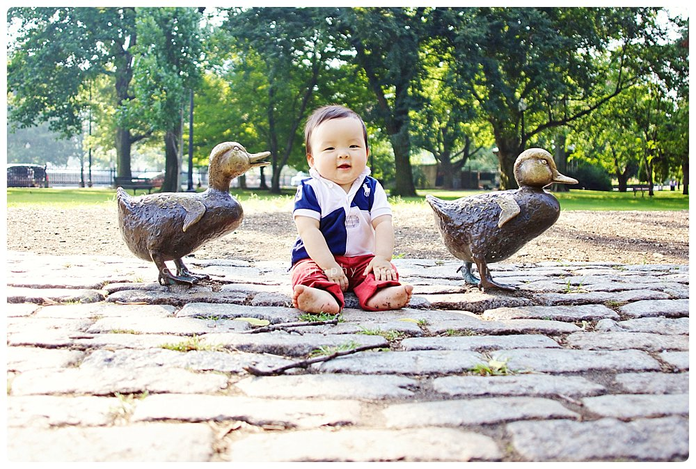 Portrait of adorable baby boy at the Make Way for Ducklings Statue in the Boston Public Garden
