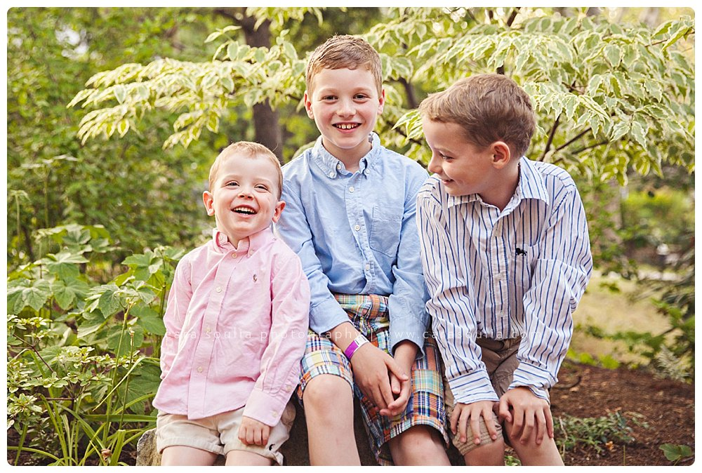 Goofy brothers posing for their family photo at home in Brookline.