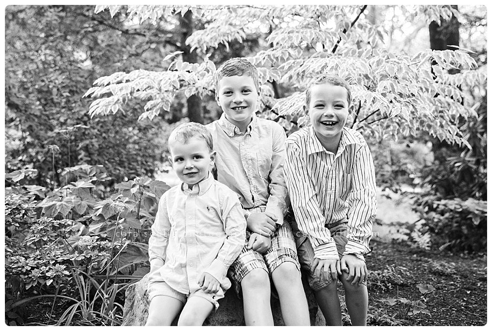 black and white photo of three brothers at their home