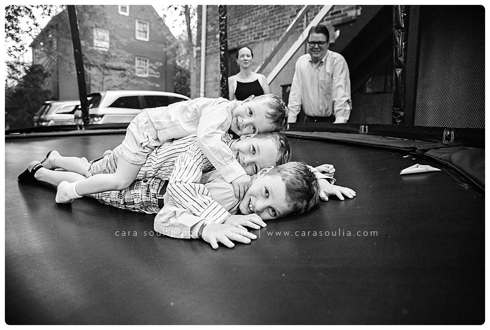 Brother sandwich on the trampoline in Brookline, MA