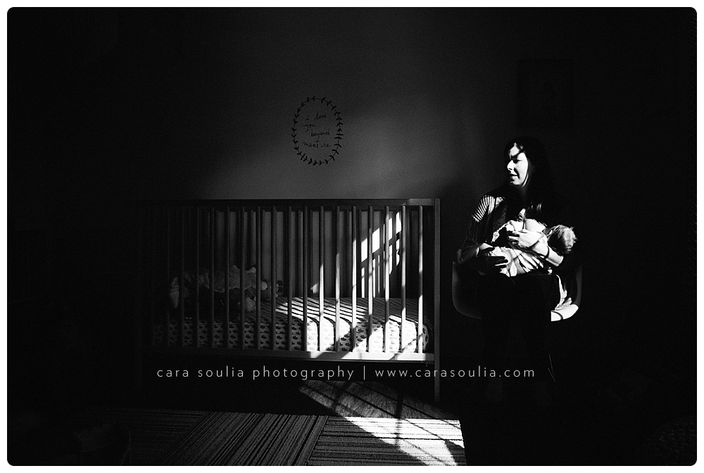 stunning unique moody photo of mama and her new baby girl