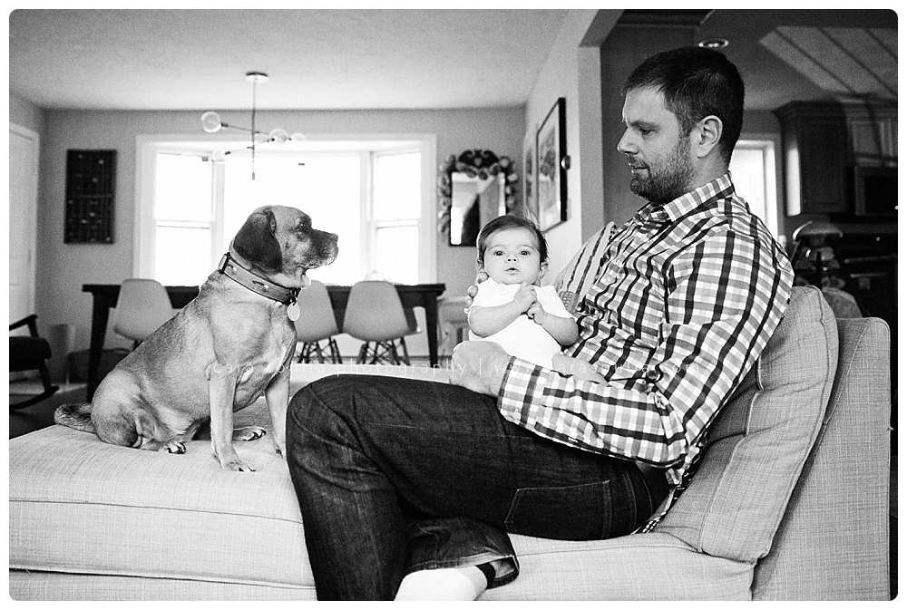 dad and his dog and newborn baby girl