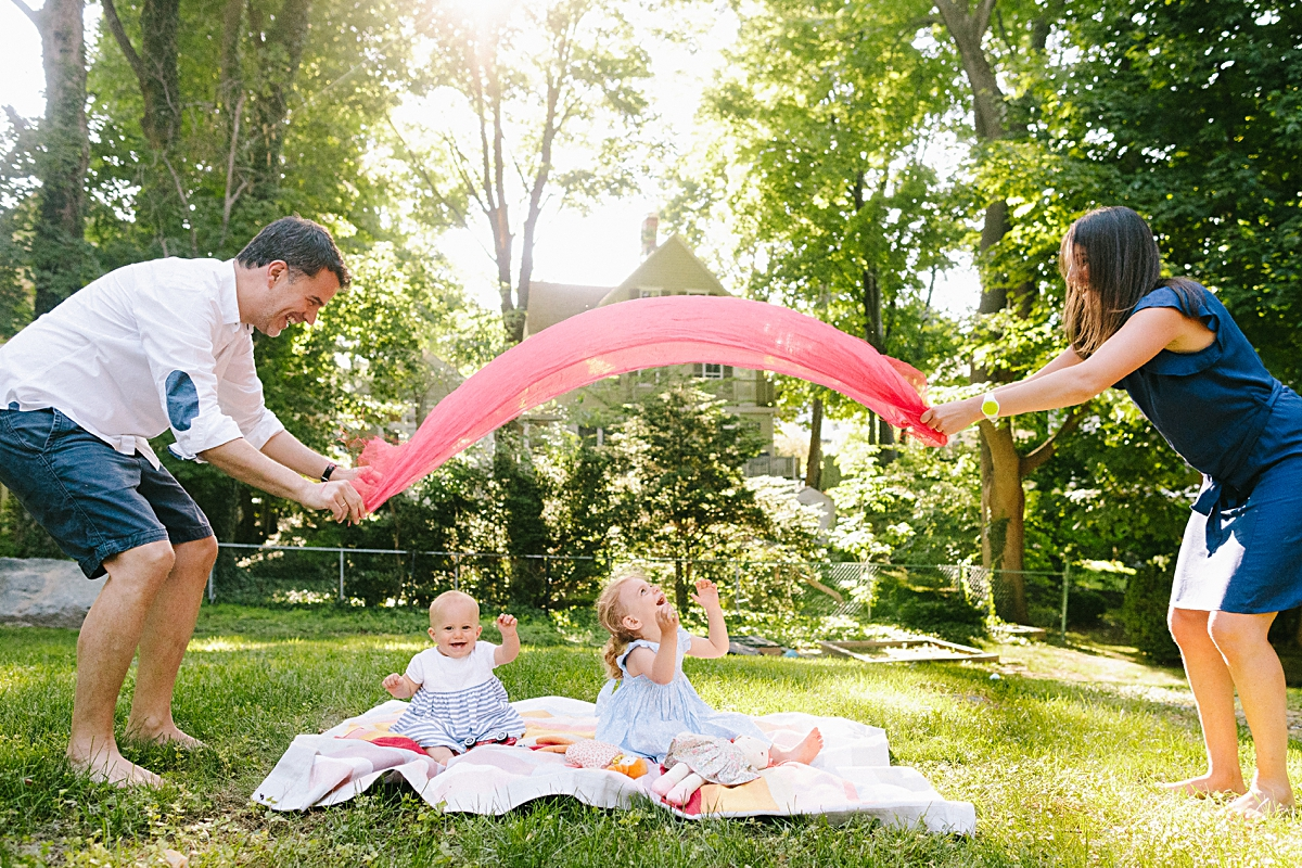 Boston family playing in backyard with young girls