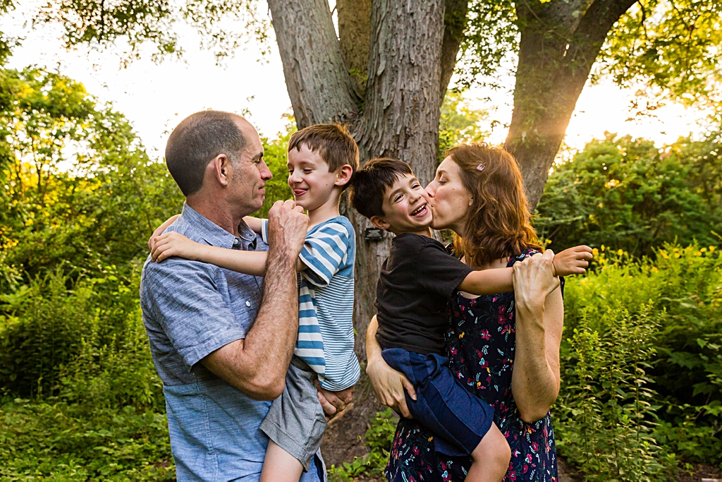 Family hugs and kisses at a Jamaica Plain family photo session