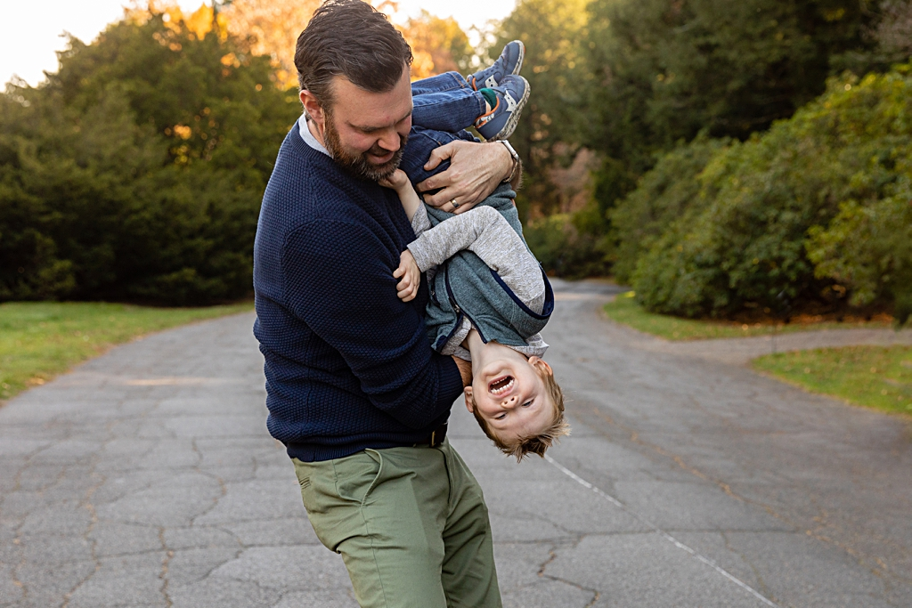 Fun play with Dad during a family photo session in Brookline