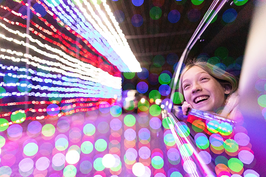 Girl in holiday lights near Boston