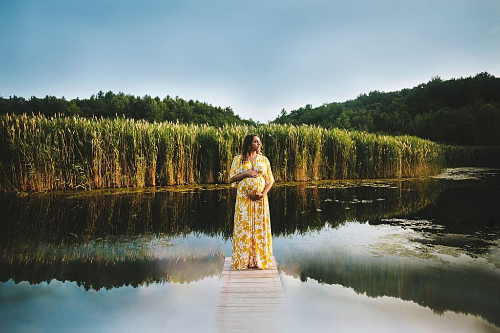 Pregnant woman in marsh at Boston maternity photo session