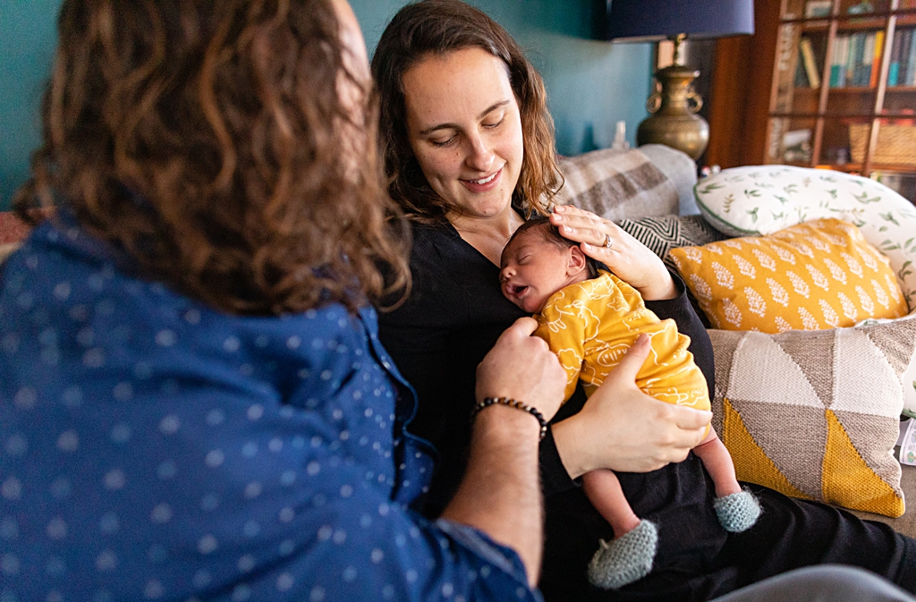 parents adoring their new baby at waltham newborn photography session