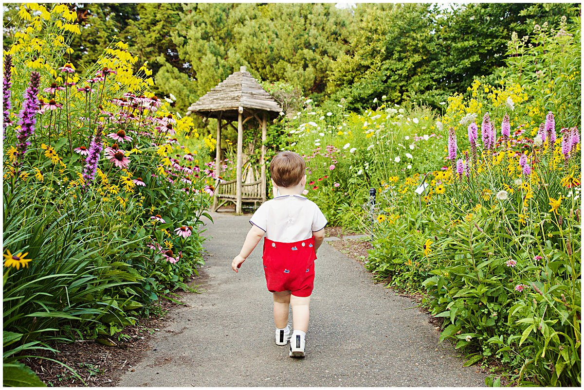 boy walking through garden in spring photo session