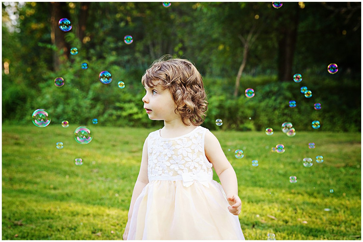 girl with bubbles in spring photo session