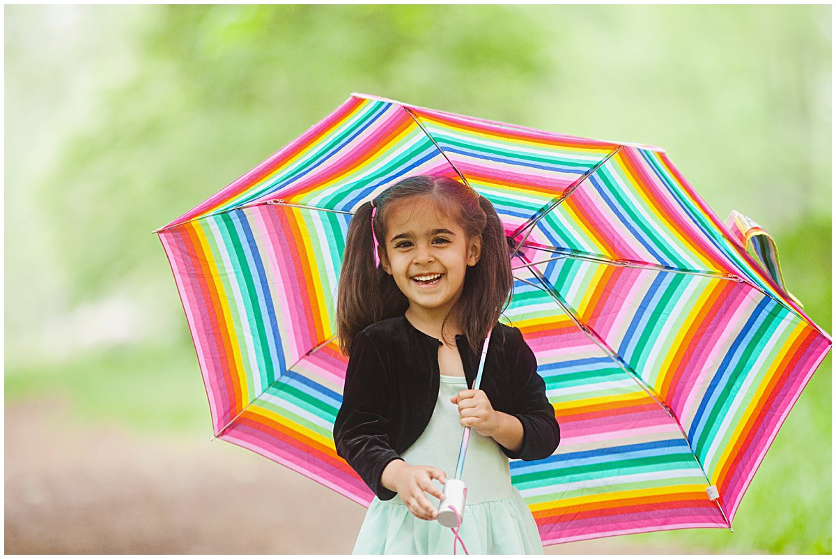 girl with umbrella during a spring photo session in boston