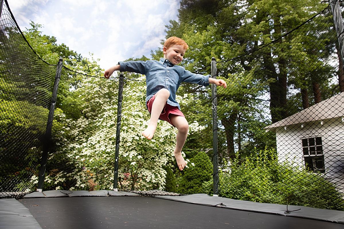 boy on trampoline by wellesley newborn photographer
